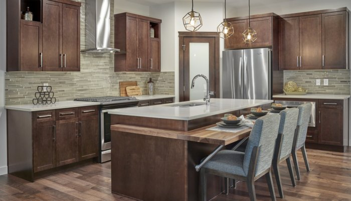 Kingsbury kitchen island and eat in bar new home builder Edmonton
