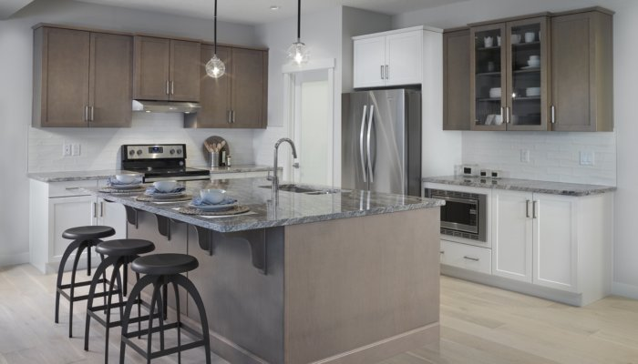 Saffron garden ii kitchen with large island new home builder edmonton
